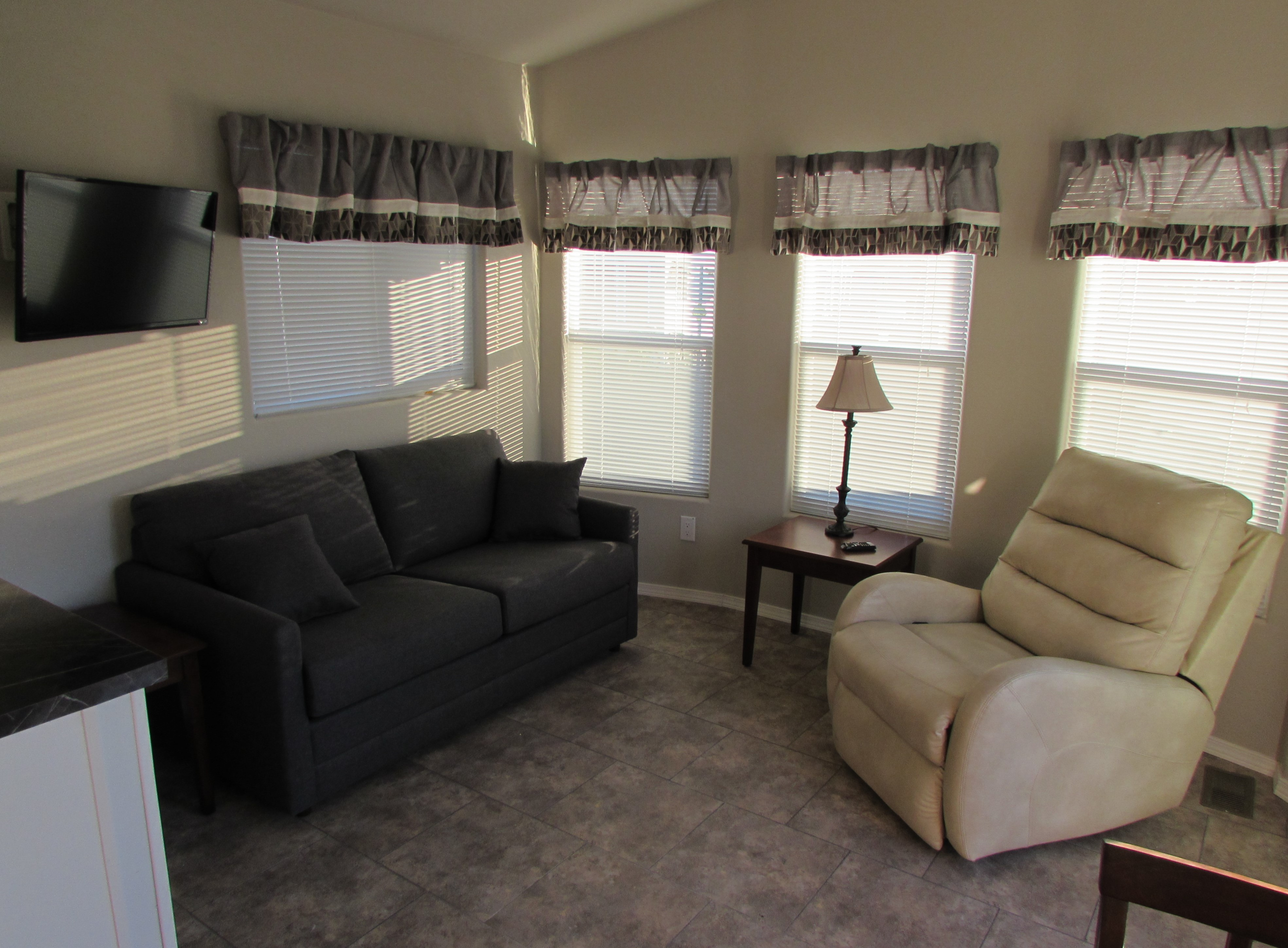 Westwind Rv Golf Resort Is Offering A Deluxe Park Model Made By Clayton Homes Featuring Ious Closet And Counter E In The Kitchen